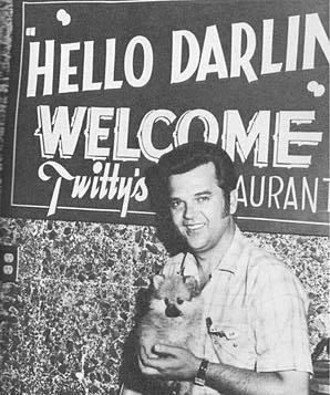 Conway Twitty and a friend pose outside his new restaurant in south Oklahoma City.
